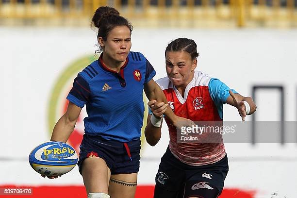 Iulia Guzeva of Russia and Camille Grassineau of France vie for the ball during the Rugby 7's Grand Prix Series Women final match between Russia and...