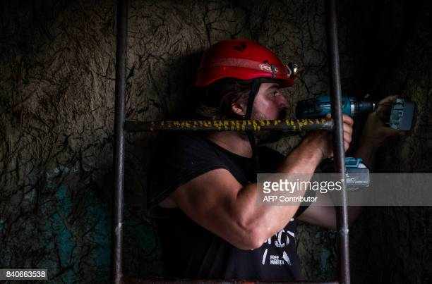 Iulian Angheluta the founder of an NGO that tries to bring electricity to remote villages prepares to install a solar panel on a house July 25 in the...