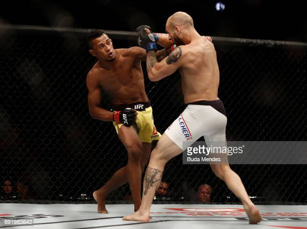 Iuri Alcantara of Brazil punches Brian Kelleher in their bantamweight bout during the UFC 212 event at Jeunesse Arena on June 3 2017 in Rio de...