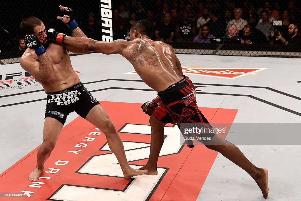 Iuri Alcantara of Brazil punches Frankie Saenz of the United States in their bantamweight bout during the UFC Fight Night at Gigantinho Gymnasium on February 22, 2015 in Porto Alegre, Brazil.