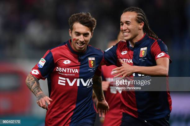 Iuri Medeiros of Genoa CFC celebrates after scoring the opening goal with team mate Diego Laxalt during the Serie A match between Genoa CFC and...