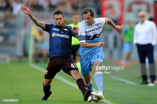 Iuri Medeiros of Genoa CFC compete for the ball with Senad Lulic of SS Lazio during the serie A match between SS Lazio and Genoa CFC at Stadio...