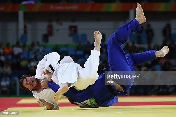 Iurii Krakovetskii of Kyrgyzstan competes against Andre Breitbarth of Germany during the Men's 100kg Judo contest on Day 7 of the Rio 2016 Olympic...