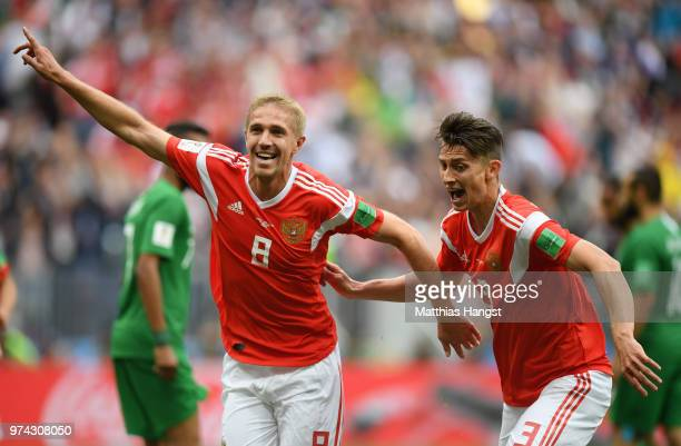 Iury Gazinsky of Russia celebrates after scoring his team's first goal during the 2018 FIFA World Cup Russia Group A match between Russia and Saudi...