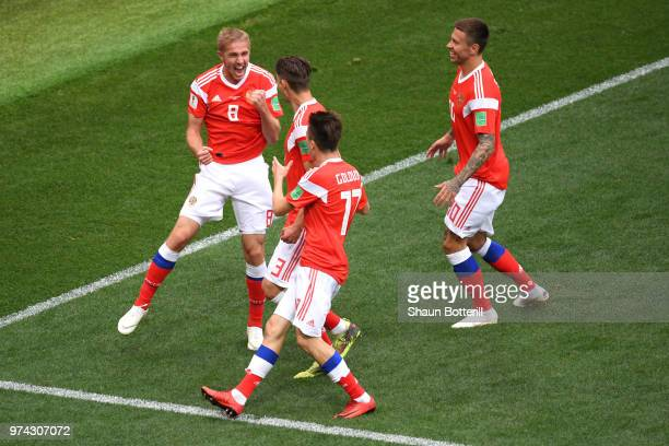 Iury Gazinsky of Russia celebrates scoring the opening goal during the 2018 FIFA World Cup Russia Group A match between Russia and Saudi Arabia at...