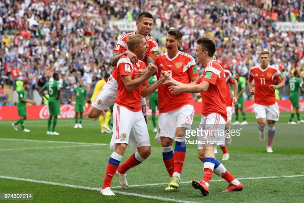 Iury Gazinsky of Russia celebrates with teammates after scoring the opening goal during the 2018 FIFA World Cup Russia Group A match between Russia...