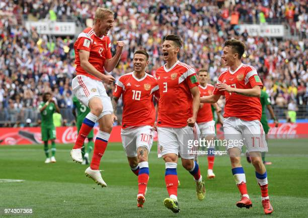 Iury Gazinsky of Russia celebrates with teammates Fedor Smolov Ilya Kutepov and Aleksandr Golovin after scoring the opening goal during the 2018 FIFA...