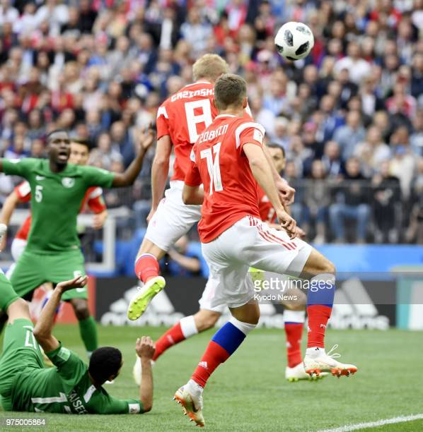 Iury Gazinsky of Russia heads in his side's first goal against Saudi Arabia during the first half of the World Cup opener in Moscow on June 14 2018...