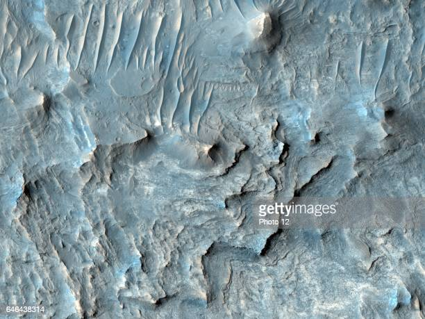 Ius Chasma is one of several canyons that make up Valles Marineris the largest canyon system in the Solar System