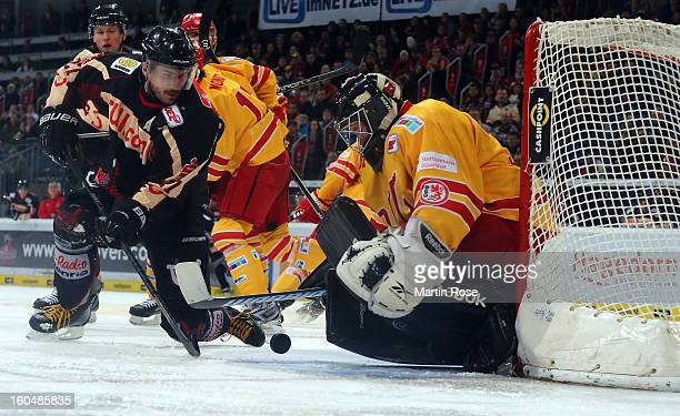 Iva Ciernik of Hannover fails to score over Felix Bick goaltender of Duesseldorf during the DEL match between Hannover Scorpions and Duesseldorfer EG...
