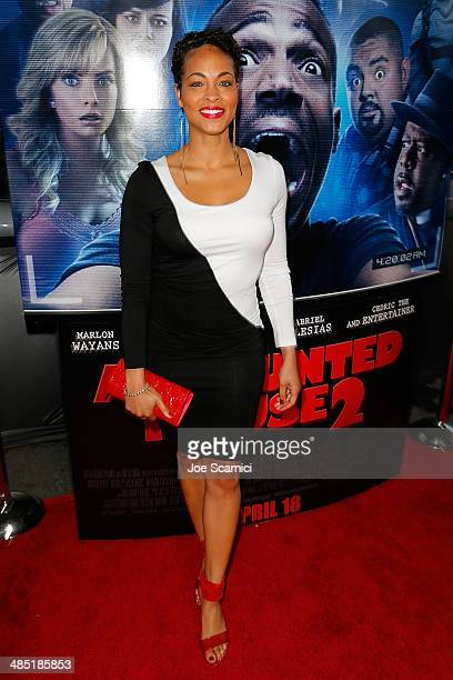 Iva La'Shawn walks the A Haunted House 2 Los Angeles Premiere Red Carpet at Regal Cinemas LA Live on April 16 2014 in Los Angeles California