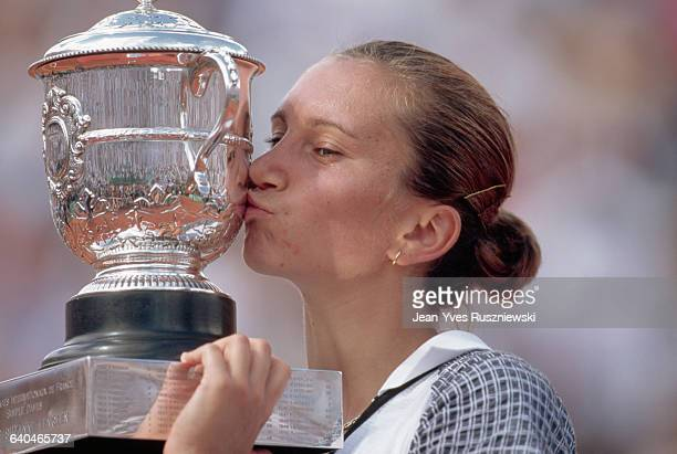 Iva Majoli kisses the winner's trophy after the finals of the French Open tennis tournament