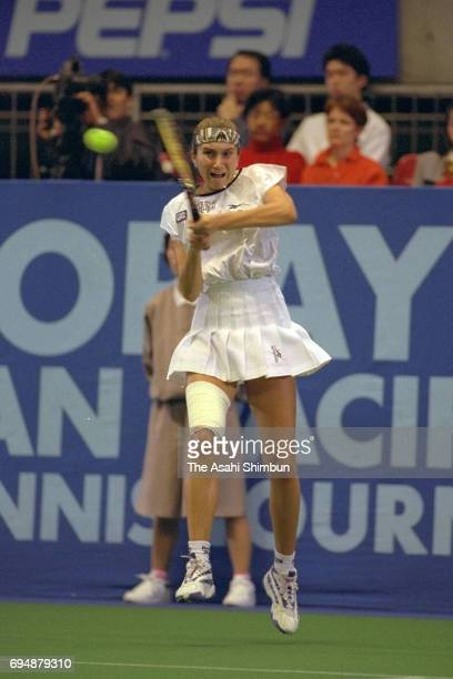 Iva Majoli of Croatia plays a backhand during the semi final against Martina Hingis of Switzerland during day five of the Toray Pan Pacific Open at...