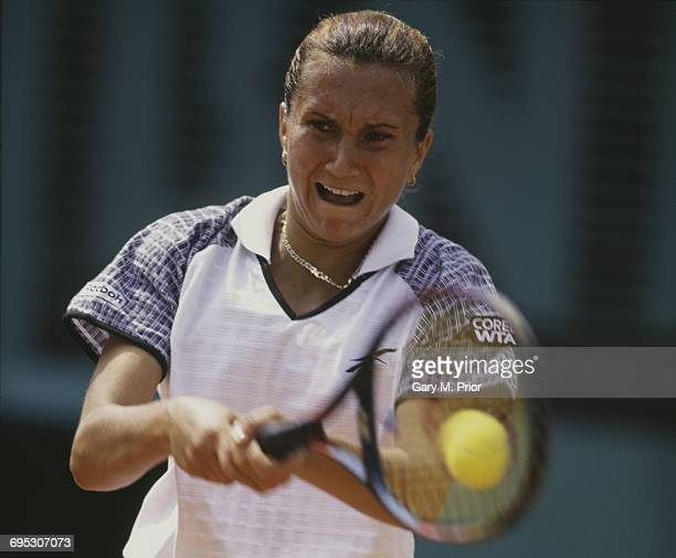 Iva Majoli of Croatia plays a backhand return to Martina Hingis during their Women's Singles Final match at the French Open Tennis Championship on 7...