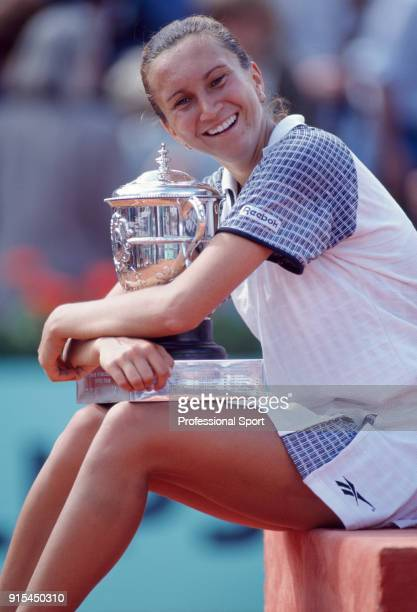 Iva Majoli of Croatia poses with the trophy after defeating Martina Hingis of Switzerland in the Women's Singles Final of the French Open Tennis...