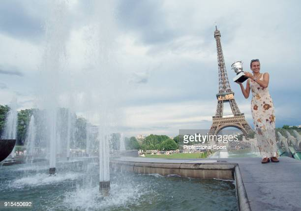 Iva Majoli of Croatia poses with the trophy in front of the Eiffel Tower after defeating Martina Hingis of Switzerland in the Women's Singles Final...