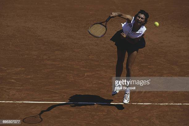 Iva Majoli of Croatia serves to Pavlina Stoyanova during their Women's Singles first round match at the French Open Tennis Championship on 26 May1998...