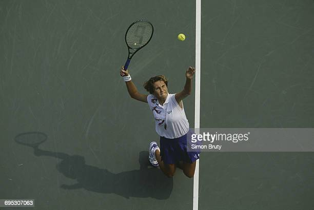 Iva Majoli of Croatia serves to Rachel McQuillan during their Women's Singles first round match of the United States Open Tennis Championship on 31...