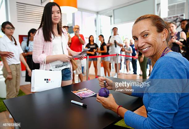 Iva Majoli of Croatia signs autographs in the Xerox booth during day three of the BNP Paribas WTA Finals tennis at the Singapore Sports Hub on...