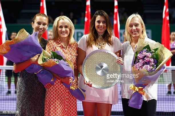 Iva Majoli of Croatia Tracy Austin of USA Marion Bartoli of France and Martina Navratilova of USA pose for the legends presentation during day six of...
