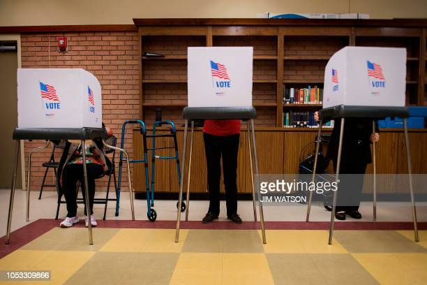 Iva Woke , a 100-year-old resident living in Chestertown, Maryland, casts he ballot in a voting booth as others do the same at the Kent County Public...