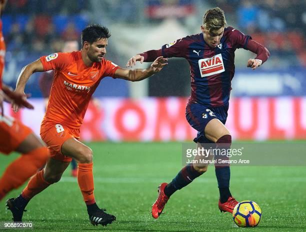 Ivan Alejo of SD Eibar duels for the ball with Adrian Gonzalez of Malaga CF during the La Liga match between SD Eibar and Malaga CF at Ipurua...