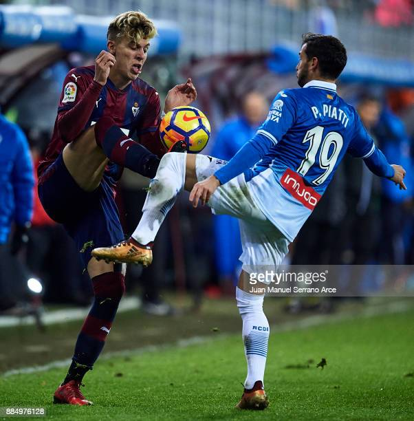 Ivan Alejo of SD Eibar duels for the ball with Pablo Daniel Piatti of RCD Espanyol during the La Liga match between SD Eibar and RCD Espanyol at...
