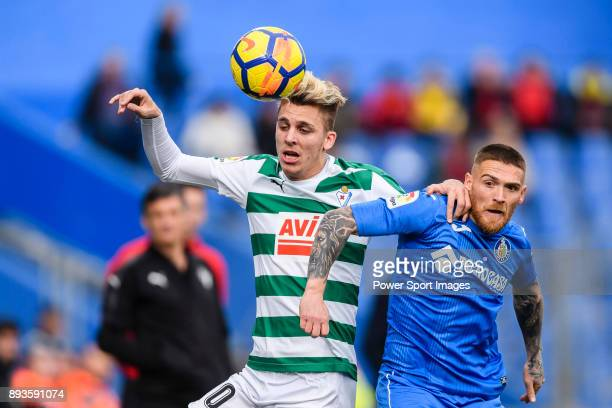 Ivan Alejo of SD Eibar fights for the ball with Vitorino Antunes of Getafe CF during the La Liga 2017-18 match between Getafe CF and SD Eibar at...