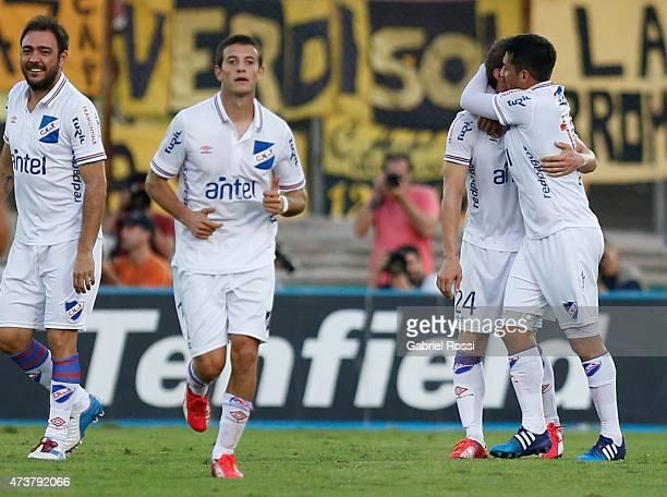 Ivan Alonso of Nacional celebrates with his teammaates after scoring the first goal of his team during a match between Penarol and Nacional as part...