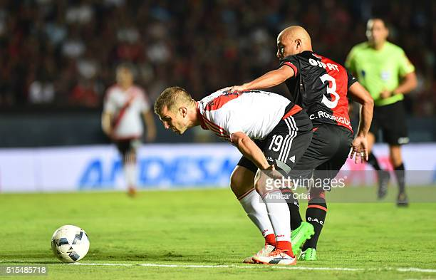 Ivan Alonso of River Plate and Clemente Rodriguez of Colon fight for the ball during a match between Colon and River Plate as part of Torneo de...
