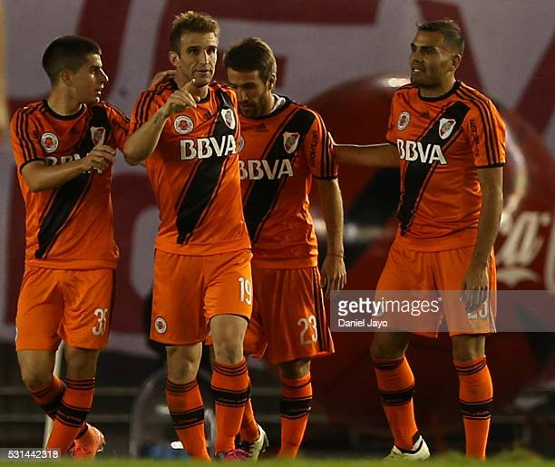 Ivan Alonso of River Plate celebrates with teammates after scoring the opening goal during a match between River Plate and Gimnasia y Esgrima La...