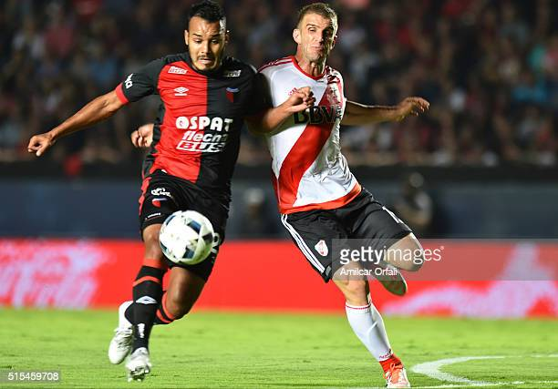 Ivan Alonso of River Plate fights for the ball with Franco Eduardo Mazurek of Colon during a match between Colon and River Plate as part of Torneo de...