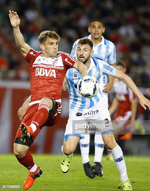 Ivan Alonso of River Plate fights for the ball with Rodrigo Colombo of Atletico Rafaela during a match between River Plate and Atletico Rafaela as...