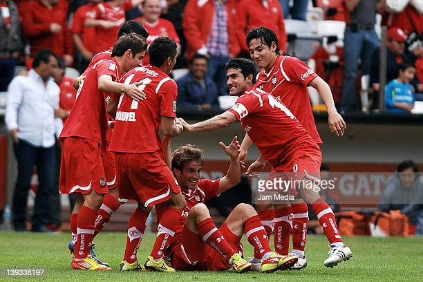 Ivan Alonso of Toluca celebrates with teammates a scored goal against Jaguares during a match between Toluca v Jaguares as part of the Clausura 2012...