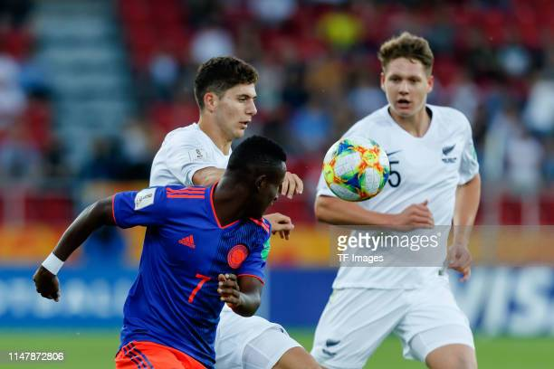 Ivan Angulo of Colombia and Liberato Cacace of New Zealand battle for the ball during the 2019 FIFA U20 World Cup Round of 16 match between Colombia...