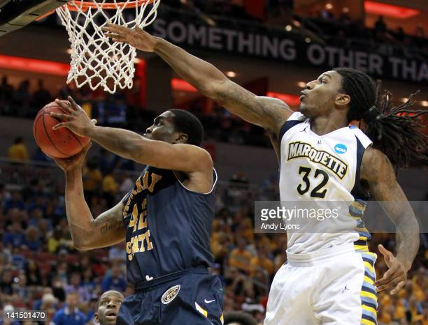 Ivan Aska of the Murray State Racers goes up for a shot against Jae Crowder of the Marquette Goldenn Eagles the second half during the third round of...