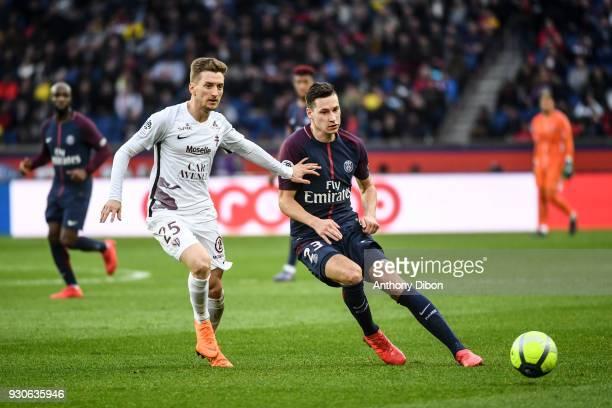 Ivan Balliu Campeny of Metz and Julian Draxler of PSG during the Ligue 1 match between Paris Saint Germain and Metz at Parc des Princes on March 10...