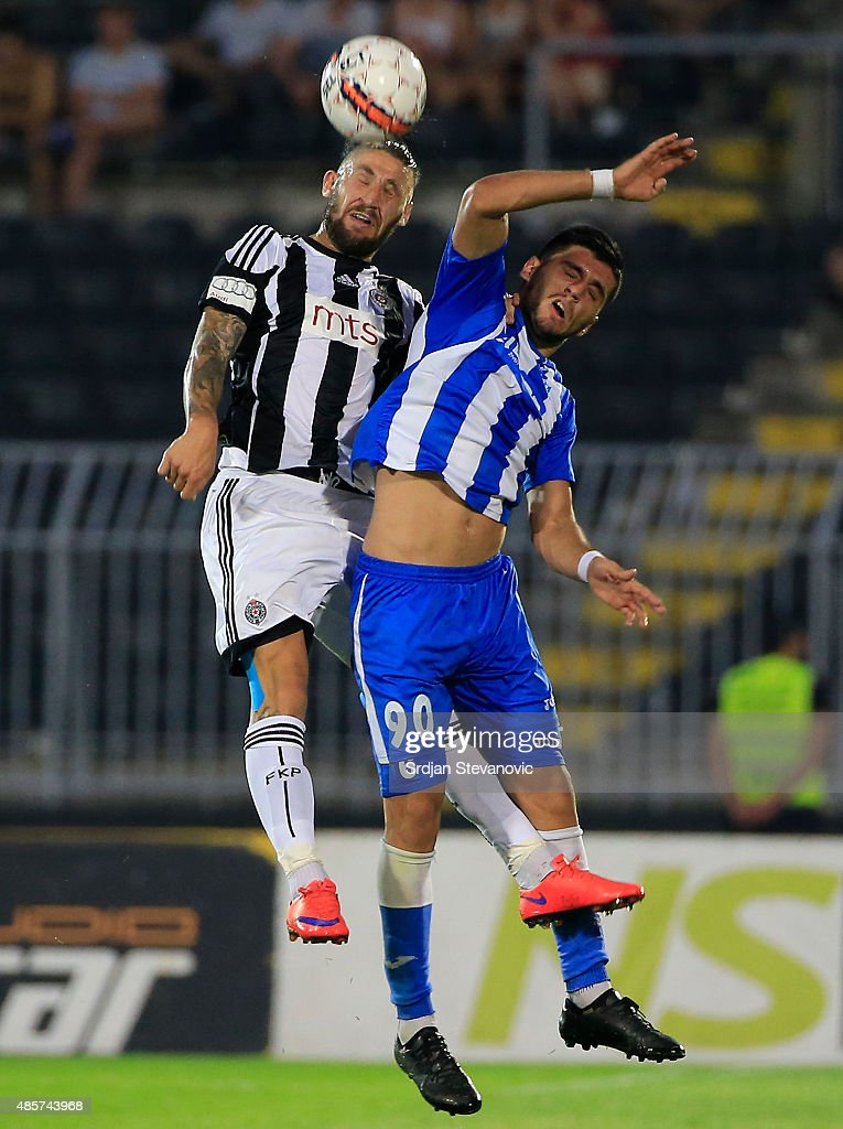 BELGRADE, SERBIA - AUGUST 29. Ivan Bandalovski (L) of FK Partizan jump for the ball against Daniel Avramovski (R) of OFK Belgrade during the Serbia Super League match between FK Partizan and OFK Belgrade at Partizan stadium August 29, 2015 in Belgrade, Serbia.