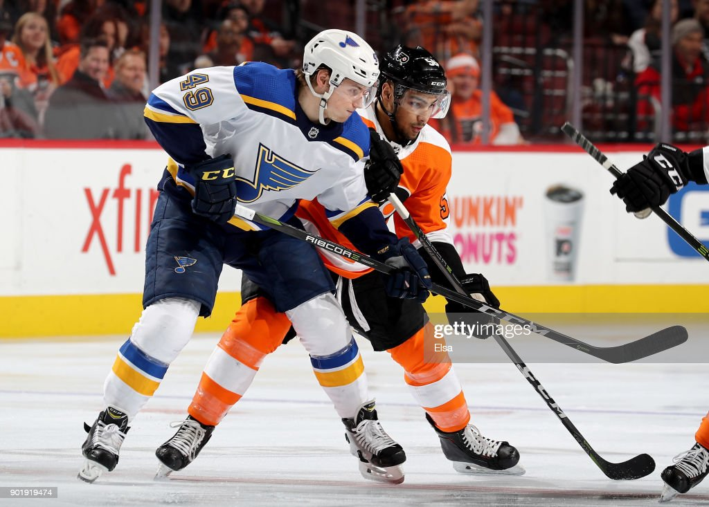 Ivan Barbashev #49 of the St. Louis Blues and Tyrell Goulbourne #56 of the Philadelphia Flyers fight for position on January 6, 2018 at Wells Fargo Center in Philadelphia, Pennsylvania.