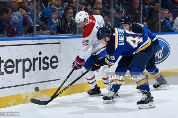 Ivan Barbashev of the St Louis Blues and Vladimir Tarasenko of the St Louis Blues battle against Karl Alzner of the Montreal Canadiens at Scottrade...