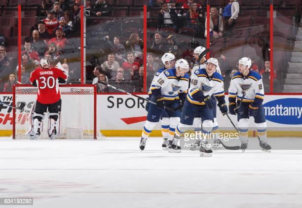 Ivan Barbashev of the St Louis Blues celebrates scoring his first career NHL goal against Andrew Hammond of the Ottawa Senators with teammates Jori...
