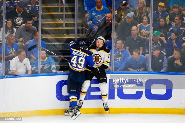 Ivan Barbashev of the St Louis Blues checks Charlie McAvoy of the Boston Bruins in Game Four of the 2019 NHL Stanley Cup Final at Enterprise Center...