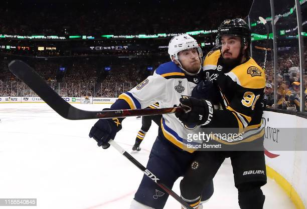 Ivan Barbashev of the St Louis Blues checks Marcus Johansson of the Boston Bruins during the second period in Game Seven of the 2019 NHL Stanley Cup...