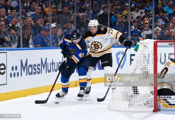 Ivan Barbashev of the St Louis Blues controls the puck as Charlie McAvoy of the Boston Bruins defends in Game Three of the Stanley Cup Final during...