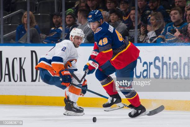 Ivan Barbashev of the St Louis Blues controls the puck as Nick Leddy of the New York Islanders defends at Enterprise Center on February 27 2020 in St...