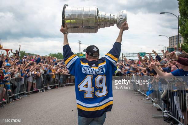 Ivan Barbashev of the St Louis Blues hoists the Stanley Cup during the St Louis Blues Victory Parade and Rally after winning the 2019 Stanley Cup...