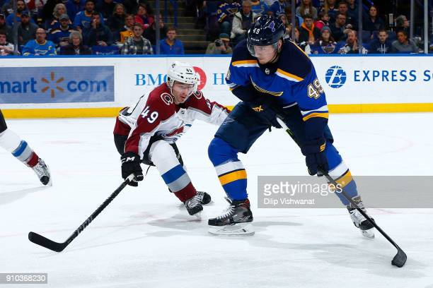 Ivan Barbashev of the St Louis Blues shoots the puck Samuel Girard of the Colorado Avalanche at Scottrade Center on January 25 2018 in St Louis...
