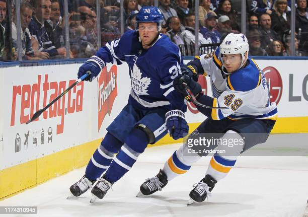 Ivan Barbashev of the St Louis Blues skates against Rasmus Sandin of the Toronto Maple Leafs during an NHL game at Scotiabank Arena on October 7 2019...