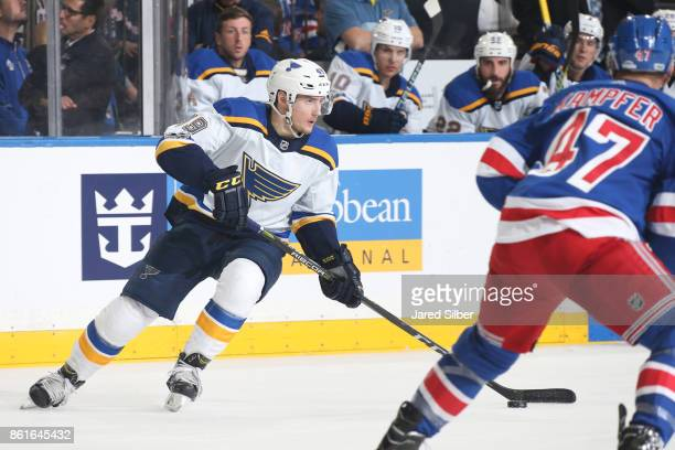 Ivan Barbashev of the St Louis Blues skates with the puck against Steven Kampfer of the New York Rangers at Madison Square Garden on October 10 2017...