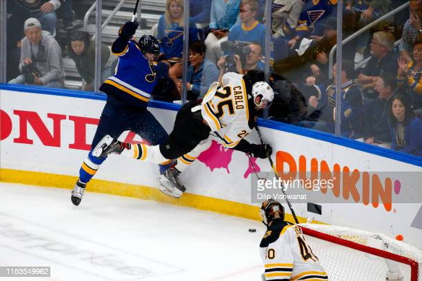 Ivan Barbashev of the St Louis Blues upends Brandon Carlo of the Boston Bruins in Game Four of the 2019 NHL Stanley Cup Final at Enterprise Center on...